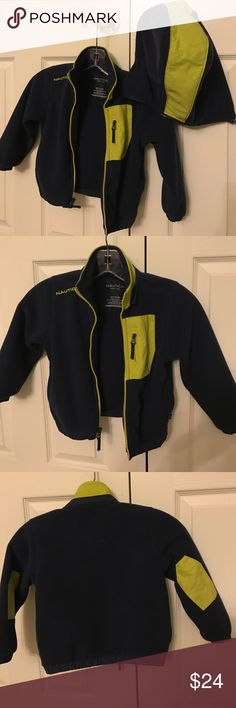 Nautica fleece jacket Nautica fleece jacket that is warm.  Has the bold neon green on the navy blue with the detachable hood.  The hood is huge, little dude never used it, I think Nautica just made one size hood for all sizes.  Its size 2/3. Runs pretty big.  You can have it for a couple of years.  Little dude grew into it.  Inside has a place for your little one's name.  From a smoke and pet free home Nautica Jackets & Coats