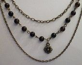 Black agate three strand antiqued gold necklace
