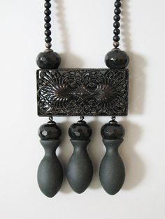 Tamara Grüner Necklace: Dona Nobis pacem, 2010 Historical pressing in blackened metal, black porcelain, plastic, pigment, blackened silver, onyx 9.5 x 5.7 x 1.8 cm