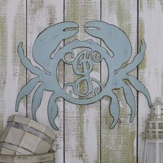 Our nautical crab monogram is sure to grab everyones attention. This crab can be finished in a variety of styles; from simple one color paint