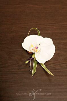 orchid boutonnière  I like the teeny dark pearl and wire accent.