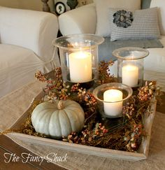 wood tray, candles and pumpkins