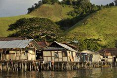 Papuan tribal houses are built on stilts on the edge of Lake Sentani