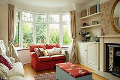 AFTER: Placing the sofa instead of the desk in the window bay makes the room seem much lig...