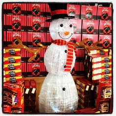 Snow man at #traderjoes guarding a mountain of cookies!