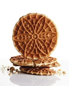 Thes crispy wafers pair perfectly with berries or ice cream. Mix batter thoroughly and pipe onto pizzelle iron; let cool until crispy, and serve with a sprinkling of powdered sugar.