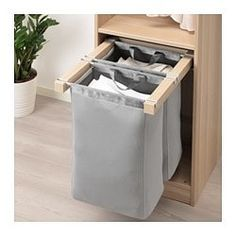 KOMPLEMENT Pull-out storage bag, white stained oak effect, cm. These pull-out storage bags are great for storing bulkier things like caps, hats or toys. Ikea Storage, Closet Storage, Bag Storage, Laundry Room Layouts, Laundry Room Design, Ikea Komplement, Pax Wardrobe, White Stain, Laundry Hamper