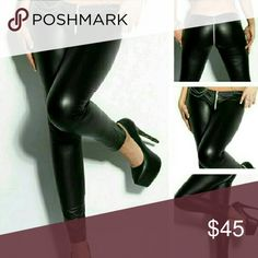 Restocked - Low-Rise Zippered Leggings Please allow an additional 3 days for mailing. Material is poly and spandex. Does not include chain belt. Added bonus of having the wet leather look. Fits sizes 8 - 12.   Only 1 available. Boutique Pants Leggings