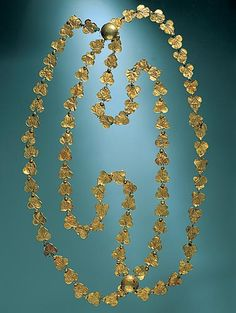 Discovered with the body of a woman fleeing down an alley in Pompeii, this long necklace, or catena-with its 94 ivy leaves of gold foil-is one of the finest pieces of jewelry found in the region. The woman also carried two uncut gems and the family silver.