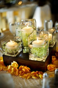 1/2 of the centerpieces were candles (multiple jars on a block of wood), the other 1/2 were floral arrangements