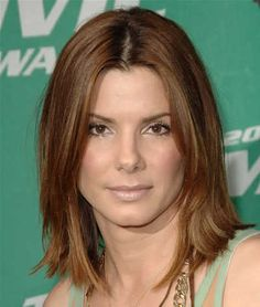 Hair? Sandra Bullock is wearing a shoulder length straight hairstyle