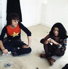 Left, John Lennon wears a star-print top with embellished pants and signature round glasses. Yoko Ono wears a printed top with tights, shorts, and platform sandals