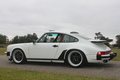1987 Porsche 911 Coupe. I loved this car so much. I think I owned it 1990-1992. This is my favorite of all my cars. I even named my cats Porsche and Carrera. POrsche was white and Carrera was black, which matched the car.
