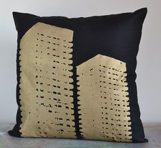'The Gallowgate Twins' - a 1970s residential tower block in Glasgow's east end are two of the most iconic buildings in Glasgow.  They can be seen from miles around.  As a child I thought they looked futuristic and now as an adult I am still fascinated by them.   This cushion is available: Gold print on black linen.  All products are individually screen printed and produced in my Glasgow Design Studio.