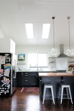 White Kitchen Vaulted Ceiling black and white ikea kitchen with subway tile, vaulted ceiling