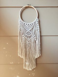 100% natural cotton macramé wall hanging.  On a 6 diameter, wooden embroidery hoop. The hanging measures about 16.5 long.  This item is made-to-order. Processing time can be up to 1-3 business days. Shipping time is 2-9 business days.  Feel free to message me if you have any questions