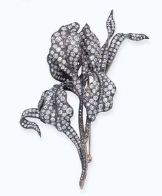 AN ANTIQUE DIAMOND SPRAY BROOCH   Designed with old-cut diamond leaves and stem, mounted in silver and gold, circa 1880, 11.0 cm high