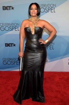 Celebrities In Leather: April Daniels wears a long black leather dress