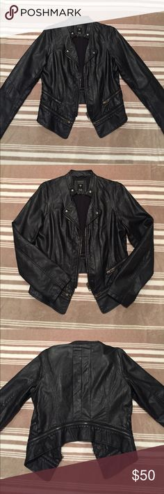 NWOT Guess Leather Jacket New without tags. Never worn. Took the tags off thinking I'd wear it but never got the chance. Black leather jacket with zipper details from Guess. Size L. Guess Jackets & Coats