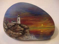 Lighthouse hand painted on a rock by wildstonepainter on Etsy, $16.00