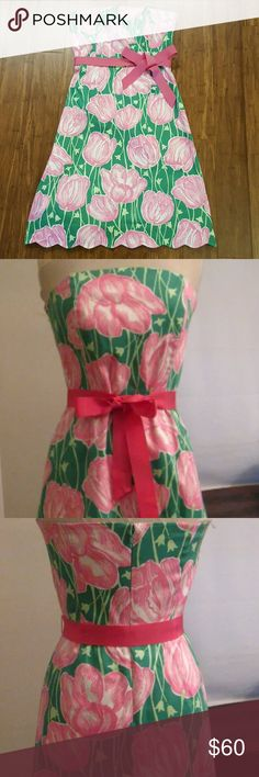 Lily Pulitzer Tulip Dress Gently used pink and green strapless dress with pink grosgrain ribbon waist tie. Scallop hem, lined zip. Small discoloration on ribbon. Size 8. Lilly Pulitzer Dresses Strapless