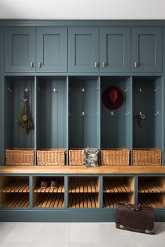 Cosy boot room with a high quality feel to it. Dark blue cabinetry was softened by adding warm oak accents and wicker storage. Tongue and groove panelling and chrome hardware complete the design. Mudroom Laundry Room, Laundry Room Design, Kitchen Design, Mudroom Cabinets, Boot Room Storage, Porch Storage, Storage Spaces, Boot Room Utility, Utility Room Designs