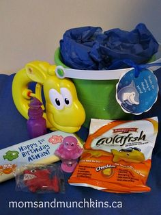 UNDER THE SEA Party:  Treat Bags-- A sm water toy, a sm bag of Shark Gummi Candy, a sm bag of Goldfish Crackers, a personalized chocolate bar, a sm ocean-themed toy, & a Tropical Fish Bubble Bottle all wrapped in blue tissue paper & placed in a sand bucket w/a personalized Shark Tag tied to the handle.