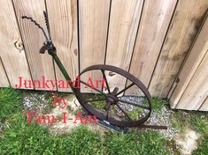 Junkyard Art by Tam-I-Am. Repurposed metal wheel into a yard snail. Scrap metal art.