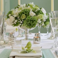 Love green and white centerpieces!