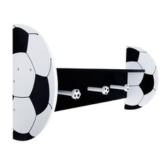Display your little one's favorite books, toys, pictures or collectibles with this Soccer Themed Wall Shelf by Trend Lab. Wood shelf features a black shelf and back with black and white soccer ball sh