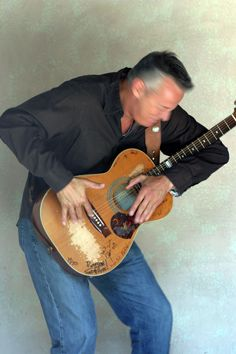 Tommy Emmanuel and his slightly used Maton guitar, made in Australia... his music has this really cool effect.you can see which parts of the guitar he plays on.