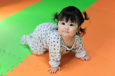 Baby with pigtails