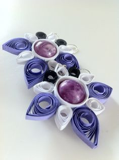 Saturn: orecchini realizzate in cartoncini colorati e perle #quilling #paper #women #jewels