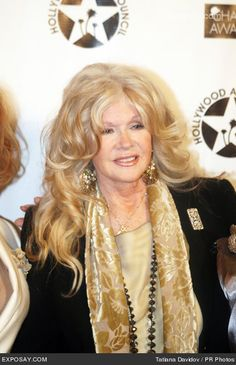 Connie Stevens, 73 this year.(And Mama said you shouldn't wear long hair after age 50) Rules are made to be broken:)