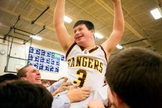 Patrick Thibodeau of the Greely High School boys hoops team after hitting a 3-pointer at the final buzzer. The smile of the day. :)