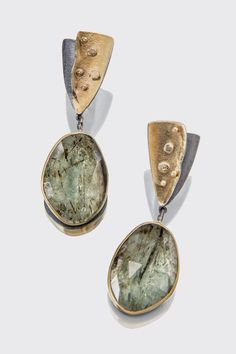 Russian emeralds, pale green with mineral inclusions that conjure up meadows and forests. http://sydneylynch.com