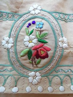 It's made of buff or gold silk/wool challis embroidereda disposition. Though rare and beautiful, the embroidery is NOT what I find most exciting about this rare dress! It looks like whoever made it up from the pre-cut pieces was larger than the pattern allowed.   eBay!