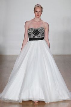 Go Bold or Go Home: Black and White Wedding Dresses...Imagine this in bridal tones & embellishments that fit your wedding theme.Work with a seamstress to achieve that special look.