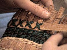 Weaving cedar bark strips into a basket