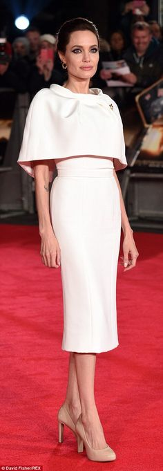 Demure: The mother-of-six cut a regal figure on the red carpet in her sophisticated dress...Puuuuuuuuuuuufect!