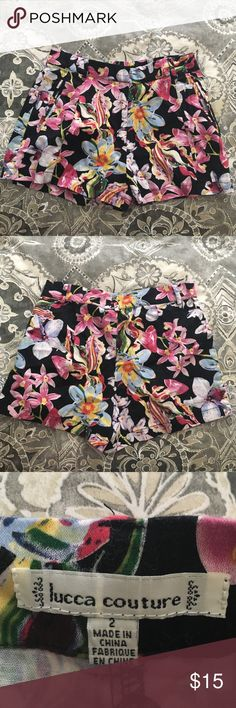 Floral print shorts Black shorts with floral print from urban outfitters. Size 2 Lucca Couture Shorts