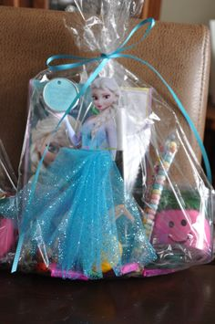 Elsa loot bag.   Photocopied picture of Elsa, hot glue gunned tulle to look like skirt.