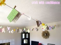Garland sorta like this, but not with the books pinned on.  Craft with Confidence: The Library Baby Shower
