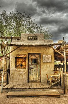 Goldfield Ghost Town - Jail | Photo By Saija Lehtonen | Back in the 1890's Goldfield boasted 3 saloons, a boarding house, general store, blacksmith shop, brewery, meat market and a school house. Just when it looked like the town would outgrow Mesa, the vein faulted, the grade of ore dropped and the town died a slow painful death. After several unsuccessful attempts to reopen the mines, the town did come to life again from 1910 on and off until 1926.