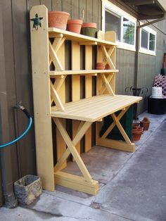 A conversion of a redwood picnic table and benches resulted in an attractive potting bench. Fence boards form the back and sides.