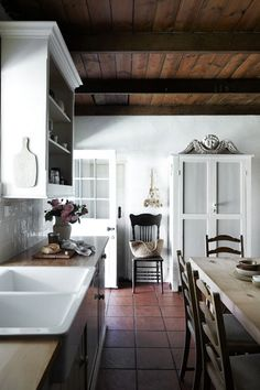 A mid-19th century shepherd's cottage has been transformed into a welcoming home. In the kitchen, the rich tones...