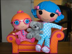 Here's a quick pic of a couple of my #Lalaloopsy dolls sitting on their new couch. The Lala on the left is Specs Reads-a-Lot, she's a the little sister of Bea Spells-a-Lot. Rosy Bumps 'n' Bruises is the cute blue-haired Lala.
