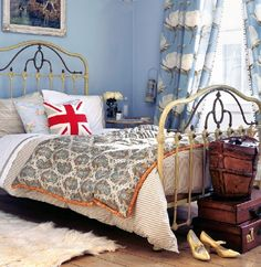 Soothing blue walls and matching curtains help tie this room, with its antique bed and vintage luggage, together. Antique Beds, Vintage Luggage, Blue Walls, Color Trends, Nook, Toddler Bed, Curtains, Antiques, Interior