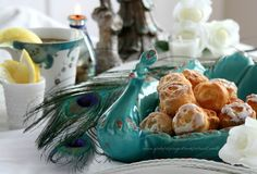 """From """"With a Grateful Prayer and a Thankful Heart"""" comes """"Peacocks and Lemon Flower Teacakes for Tablescape."""" I'm pinning this for the gorgeous peacock serving dish, but if you're interested in the recipe for the Lemon Flower Teacakes, it's at the click-through."""