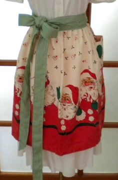 santa apron--Mom made Putzi & I aporns--same 1960's fabric but ours--christmas cats. I still have mine...Y